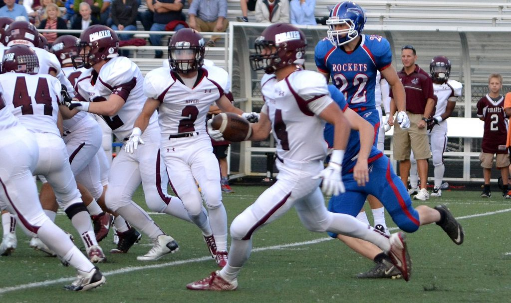 Rocky River quarterback Eric Jones ran for a 35-yard touchdown in the first half of the victory at Bay Friday night. Photo – Ryan Kaczmarski