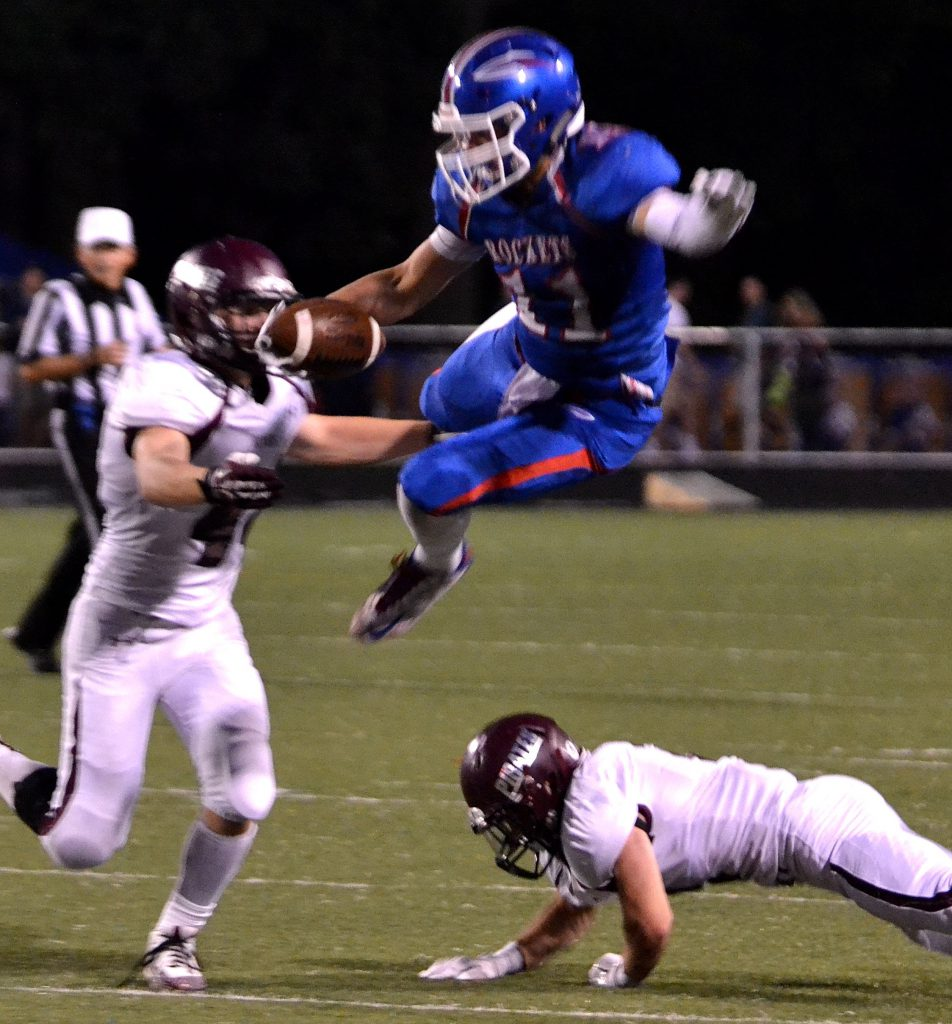 Bay senior wide receiver Cole Gergye took the high road for a reception in Friday's loss to Rocky River. Photo – Ryan Kaczmarski