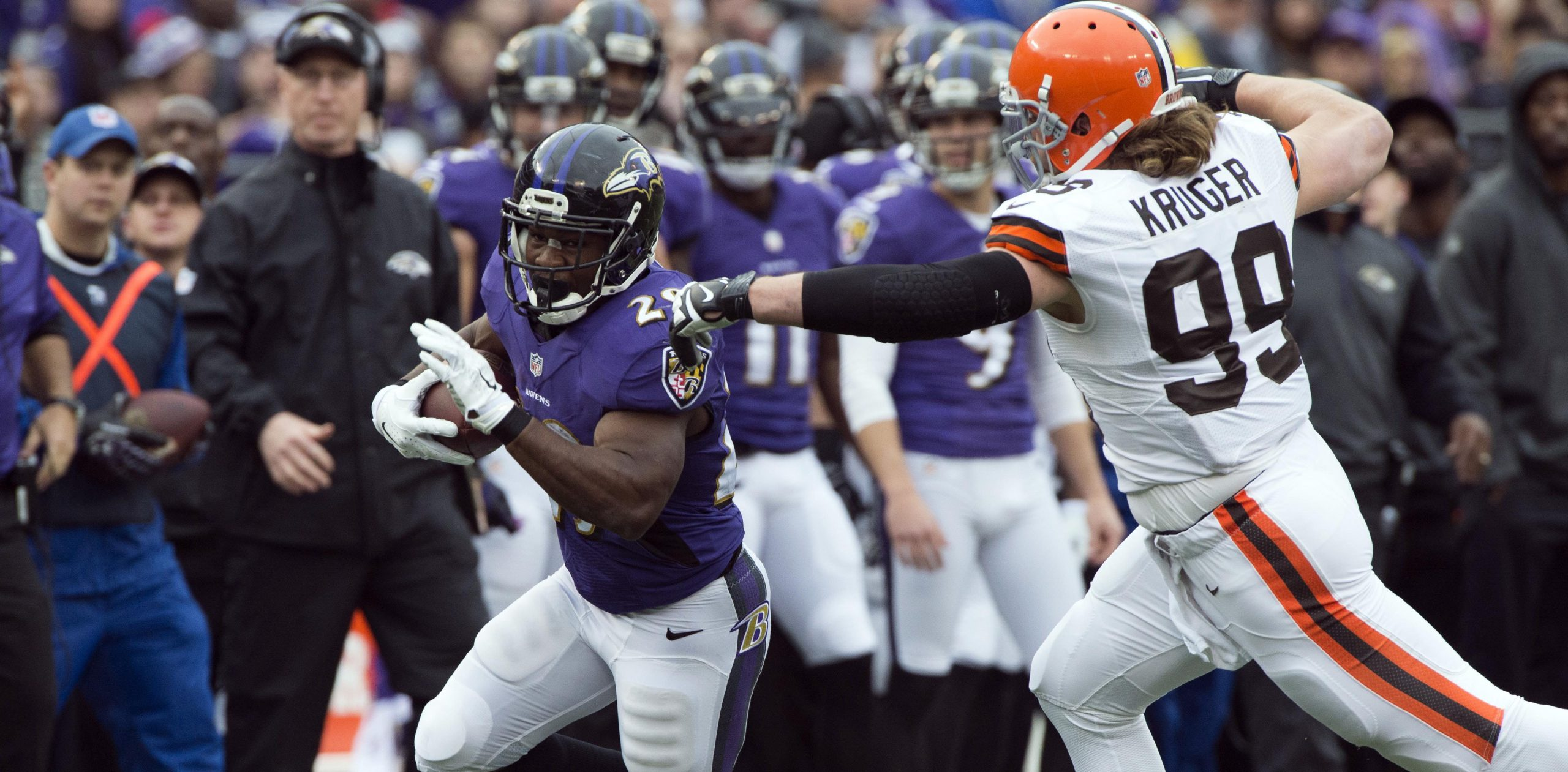 Dec 28, 2014; Baltimore, MD, USA; Baltimore Ravens running back Justin Forsett (29) runs past Cleveland Browns outside linebacker Paul Kruger (99) during the first quarter at M&T Bank Stadium. Mandatory Credit: Tommy Gilligan-USA TODAY Sports