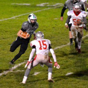 Columbia quarterback Cody Schwartz used his legs and his arm to move to ball Friday night. Photo – Ryan Kaczmarski