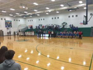 The Rockets and the Green Wave stand while awaiting the National Anthem.